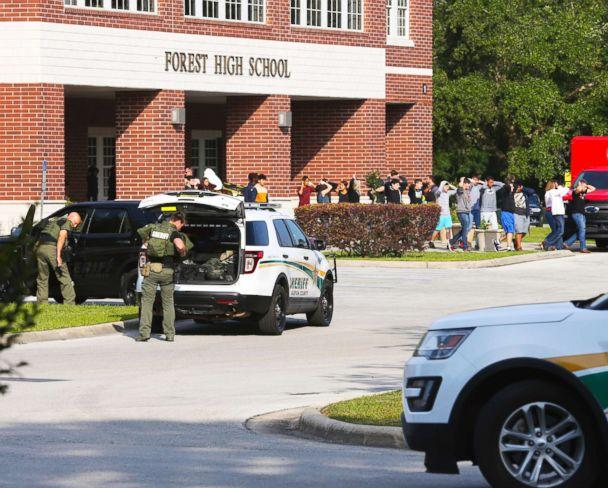PHOTO: Students are led out of Forest High School as law enforcement agents prepare to enter the school on April 20, 2018, in Ocala, Fla. (Bruce Ackerman/Star-Banner via AP)