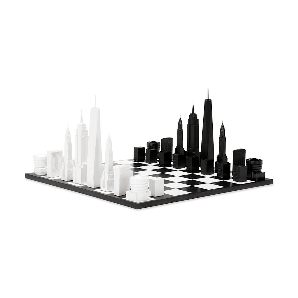 """<p><strong>The Moma</strong></p><p>moma.org</p><p><strong>$135.00</strong></p><p><a href=""""https://store.moma.org/kids/toys-games/nyc-skyline-chess-set/2628-128944.html"""" rel=""""nofollow noopener"""" target=""""_blank"""" data-ylk=""""slk:Shop Now"""" class=""""link rapid-noclick-resp"""">Shop Now</a></p><p>This beautiful black and white chess set features some of the most prominent buildings in the New York City skyline. </p>"""
