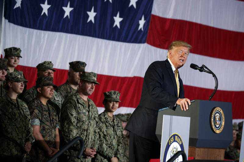 President Donald Trump speaks to troops at a Memorial Day event aboard the USS Wasp, Tuesday, May 28, 2019, in Yokosuka, Japan. (AP Photo/Evan Vucci)