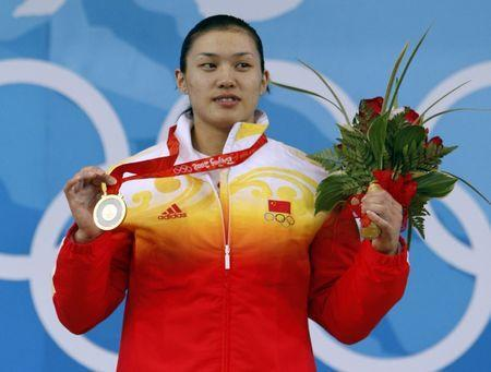 FILE PHOTO: Cao Lei of China poses with her gold medal in the women's 75kg weightlifting competition at the Beijing 2008 Olympic Games August 15, 2008. REUTERS/Yves Herman