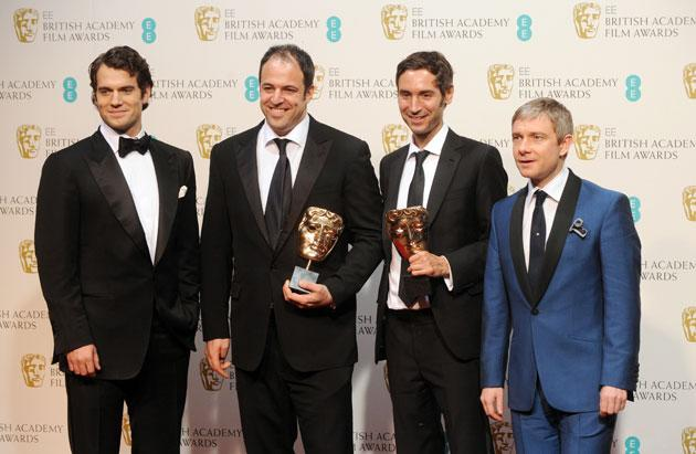 Simon Chinn (2nd from L) and Malik Bendjelloul (2nd from R) , winners of the Documentry award for 'Searching For Sugar Man', pose in the press room with presenters Henry Cavill (L) and Martin Freeman (R) at the EE British Academy Film Awards at The Royal Opera House on February 10, 2013 in London, England. (Photo by Stuart Wilson/Getty Images)
