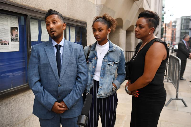 The father of Tashan Daniel, Chandy Daniel, alongside mother Cecia Daniel (right) and sister Oceanna Daniel (centre), speaks to the media outside the Old Bailey, London, after Alex Lanning was found guilty of murdering talented athlete Tashan Daniel, who died after he was stabbed on his way to a football match at the Emirates stadium in west London on September 24, 2019. Co-defendant Jonathan Camille was cleared of murder but convicted of manslaughter.