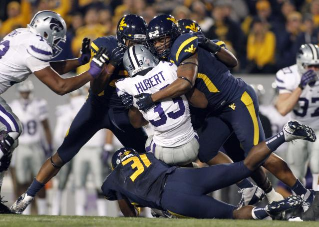 MORGANTOWN, WV - OCTOBER 20: The West Virginia Mountaineers defense stops John Hubert #33 of the Kansas State Wildcats during the game on October 20, 2012 at Mountaineer Field in Morgantown, West Virginia. (Photo by Justin K. Aller/Getty Images)