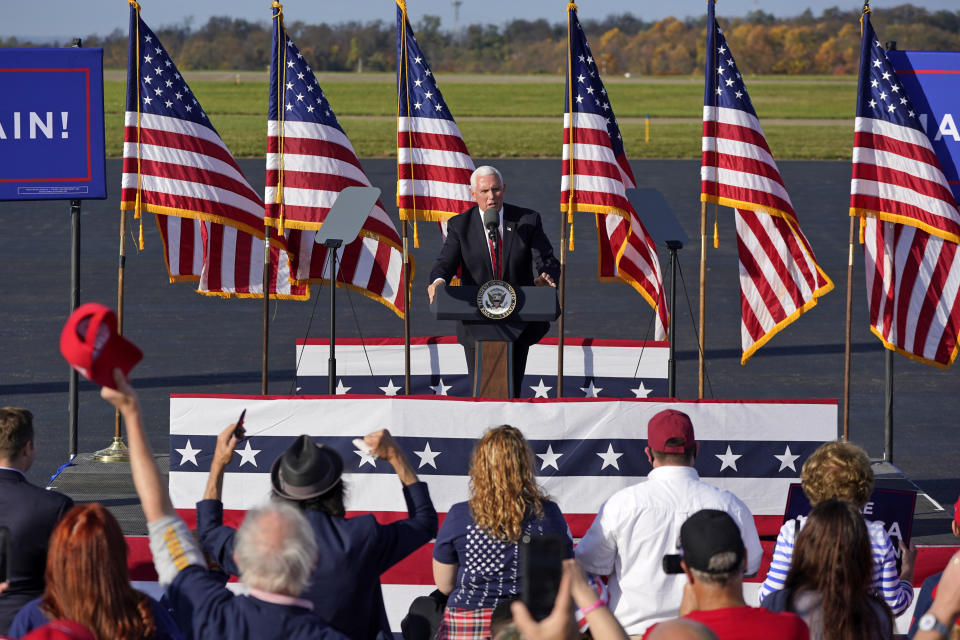 Mike Pence delivers remarks at a campaign rally on an airport tarmac