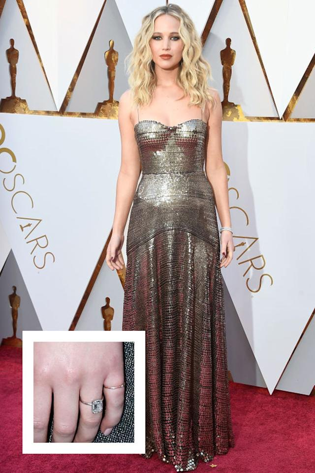 """<p>The actress got engaged to<a rel=""""nofollow"""" href=""""https://www.townandcountrymag.com/the-scene/weddings/a26190886/who-is-cooke-maroney-jennifer-lawrence/""""> art dealer Cooke Maroney</a> in February 2019. A few weeks later, Lawrence debuted <a rel=""""nofollow"""" href=""""https://www.townandcountrymag.com/style/jewelry-and-watches/a26535238/jennifer-lawrence-cooke-maroney-engagement-ring-worth-cost-details/"""">her massive engagement ring</a>, which appears to feature a four to five carat elongated cushion or emerald cut diamond center stone in a white gold or platinum solitaire setting. The ring is estimated to cost between $60,000 to $100,000, approximately.</p>"""