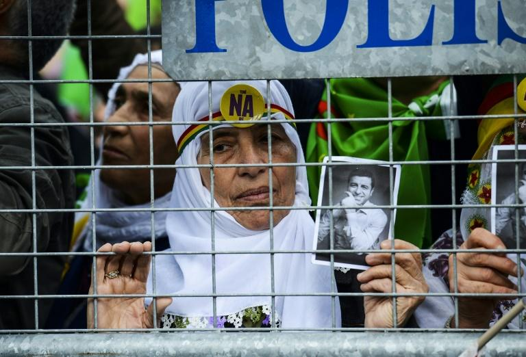 A Kurdish woman holds a photo of the jailed co-leader of the opposition pro-Kurdish Peoples' Democratic Party (HDP), Selahattin Demirtas, at an eve-of-referendum rally in Diyarbakir