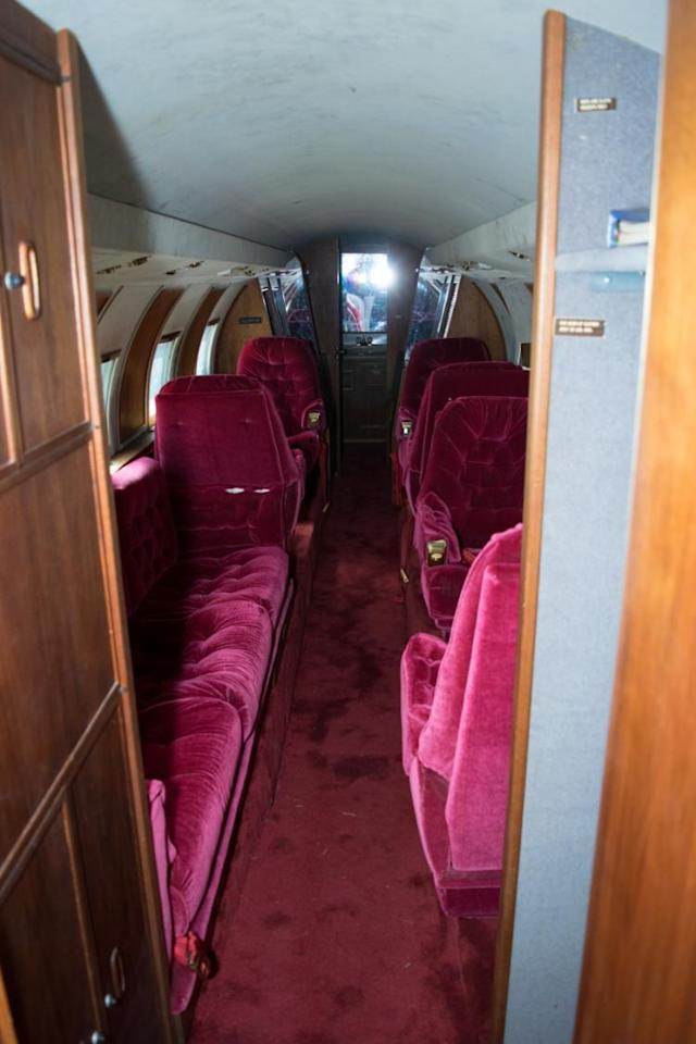 """<p>Here's the view from the rear of the plane, looking toward the cockpit. Your <a href=""""https://www.youtube.com/watch?v=T1Ond-OwgU8"""" rel=""""nofollow noopener"""" target=""""_blank"""" data-ylk=""""slk:blue suede shoes"""" class=""""link rapid-noclick-resp"""">blue suede shoes</a> would contrast nicely with the interior. </p>"""