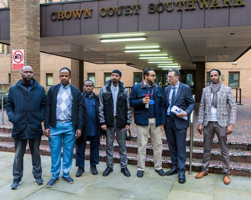 James Farrar, 2nd right, with Uber drivers supporting him, outside Southwark Crown Court in London. London, January 13 2020. See National News story NNmegaphone