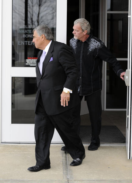 Attorney James Voyles, left and Indianapolis Colts owner Jim Irsay leave the Hamilton County Jail in Indianapolis, Monday, March 17, 2014. Irsay was released from jail Monday after being held overnight following a traffic stop in which police said he failed sobriety tests and had multiple prescription drugs inside his vehicle. Irsay was pulled over late Sunday after he was spotted driving slowly near his home in suburban Carmel, stopping in the roadway and failing to use a turn signal. (AP Photo/Alan Petersime)