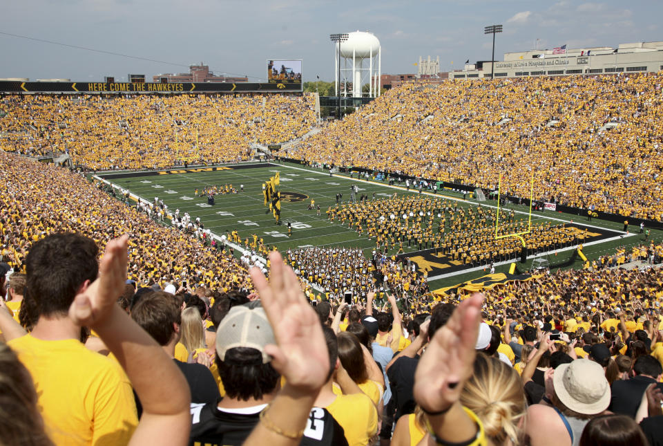 IOWA CITY, IOWA- SEPTEMBER 16:  Fans cheer as the Iowa Hawkeyes take the field before the match-up against the North Texas Mean Green on September 16, 2017 at Kinnick Stadium in Iowa City, Iowa.  (Photo by Matthew Holst/Getty Images)