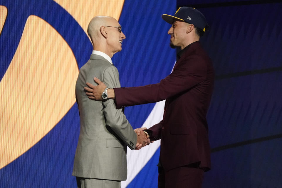 Chris Duarte, right, greets NBA Commissioner Adam Silver after being selected as the 13th overall pick by the Indiana Pacers during the NBA basketball draft, Thursday, July 29, 2021, in New York. (AP Photo/Corey Sipkin)