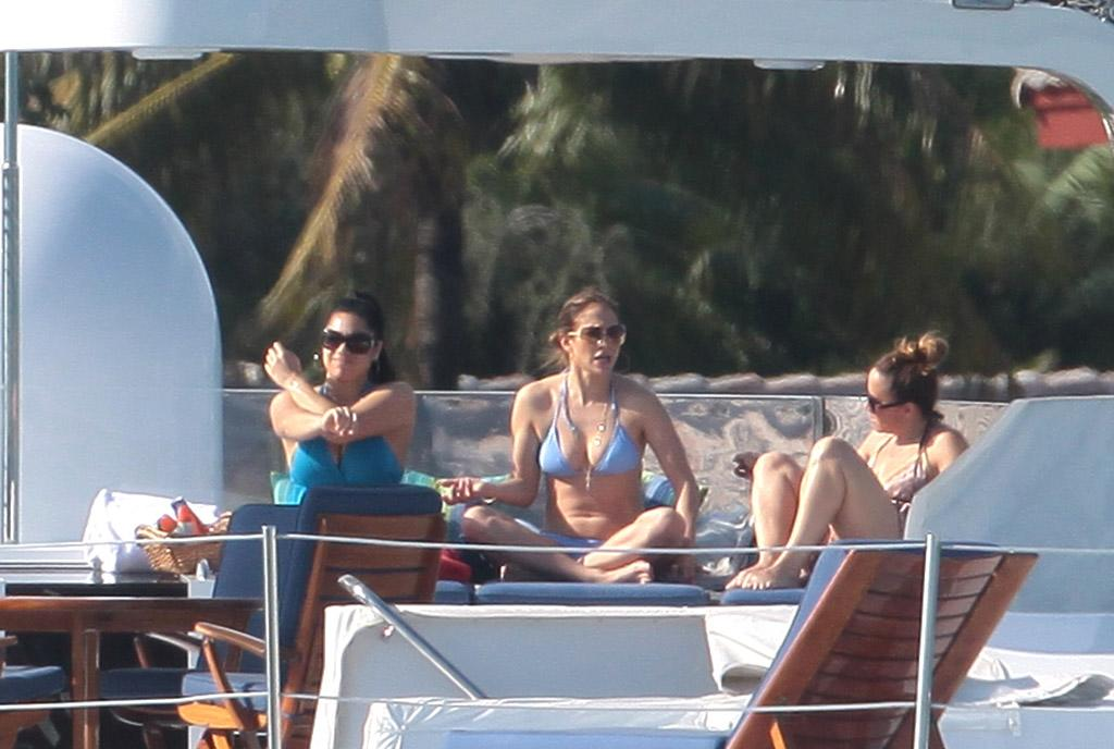 Jennifer Lopez enjoys an afternoon with friends and family on The Superyacht Utopia III in Miami Beach.