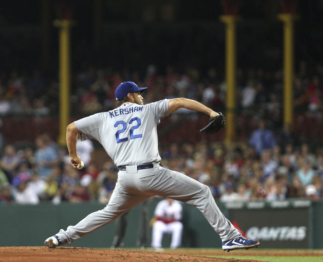 Dodgers' Clayton Kershaw pitches during the the Major League Baseball opening game between the Los Angeles Dodgers and Arizona Diamondbacks at the Sydney Cricket Ground in Sydney, Australia Saturday, March 22, 2014. The Dodgers won the game 3-1. (AP Photo/Michelle O'Connor)