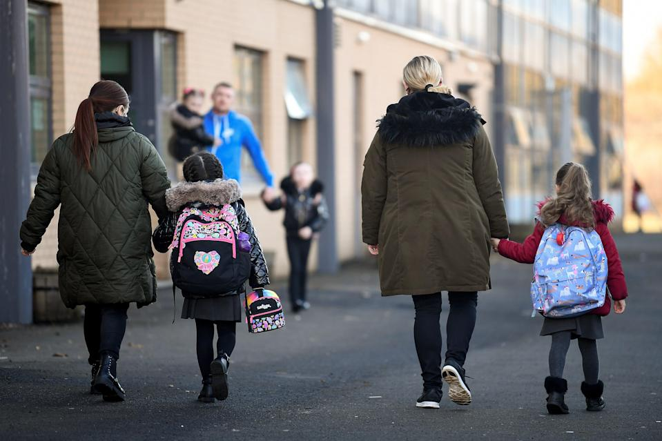 <p>Pupils at Cleeves Primary School return to the classroom on 22 February 2021 in Glasgow</p> (Getty)
