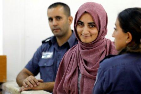 FILE PHOTO: Turkish citizen, Ebru Ozkan, who was arrested at an Israeli airport last month, being brought to an Israeli military court near Migdal, Israel July 8, 2018 REUTERS/Nir Elias