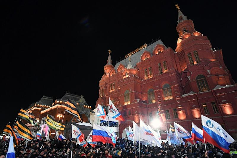 People attend a rally and a concert celebrating the fourth anniversary of Russia's annexation of Crimea at Manezhnaya Square in Moscow in March 2018