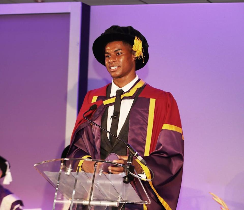 Marcus Rashford collects an honorary doctorate from the University of Manchester at the Old Trafford Centre (Manchester United Football Club/PA)