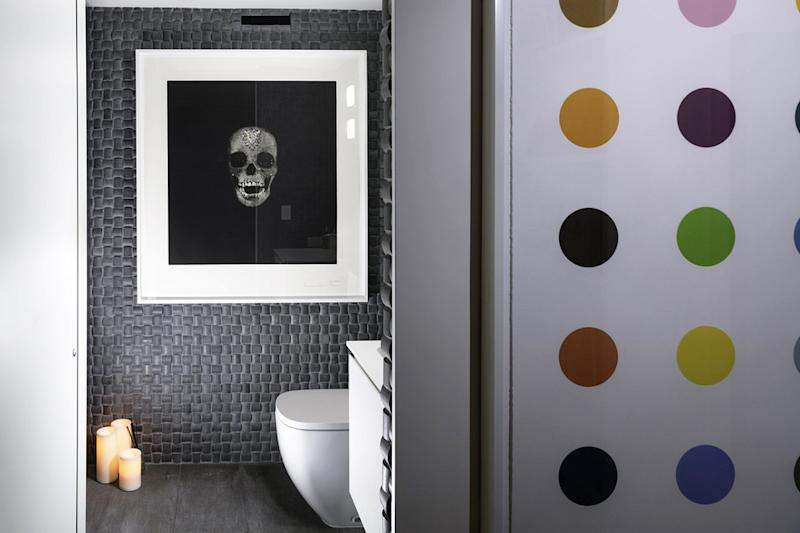 The bathroom in Simon and Parmiss Mass's Hollywood, Fla., home features 'Victory Over Death,' a photogravure etching by Damien Hirst.