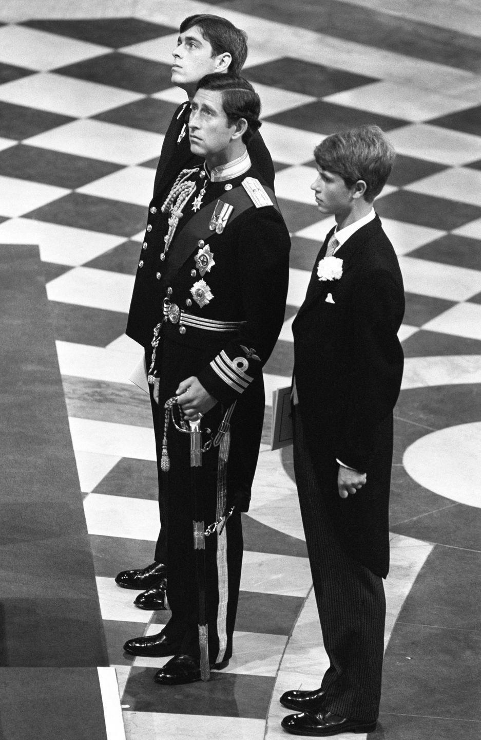 <p>Prince Charles patiently waits for Diana to arrive while flanked by his two groomsmen, brothers Prince Andrew and Prince Edward. </p>