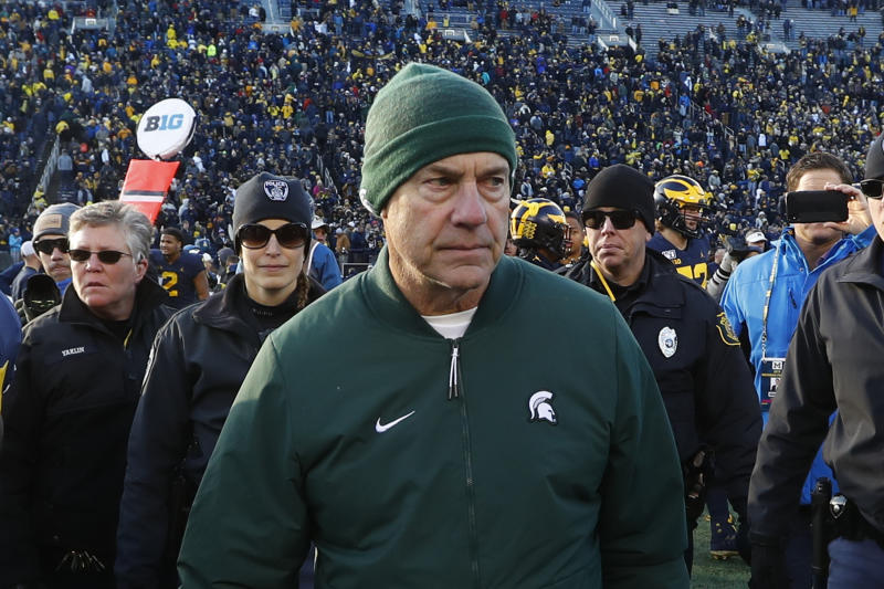 Michigan State head coach Mark Dantonio leaves the field after an NCAA college football game against Michigan in Ann Arbor, Mich., Saturday, Nov. 16, 2019. (AP Photo/Paul Sancya)