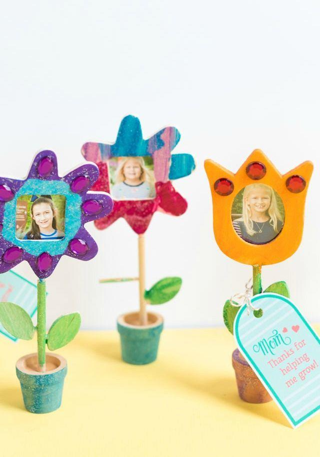 "<p>Moms help their kids every step of the way — from seeds to full blooms — and this gift symbolizes just that. Fill the center of each flower with a picture, so it serves as a timestamp of this year's holiday. </p><p><em><a href=""https://designimprovised.com/2019/04/mom-week-mothers-day-photo-flowers.html"" rel=""nofollow noopener"" target=""_blank"" data-ylk=""slk:Get the tutorial at Design Improvised »"" class=""link rapid-noclick-resp"">Get the tutorial at Design Improvised »</a></em></p><p><strong>RELATED: </strong><a href=""https://www.goodhousekeeping.com/holidays/mothers-day/g20115272/mothers-day-gifts-from-toddlers/"" rel=""nofollow noopener"" target=""_blank"" data-ylk=""slk:Sweet Mother's Day Gifts from Toddlers"" class=""link rapid-noclick-resp"">Sweet Mother's Day Gifts from Toddlers </a><br></p>"