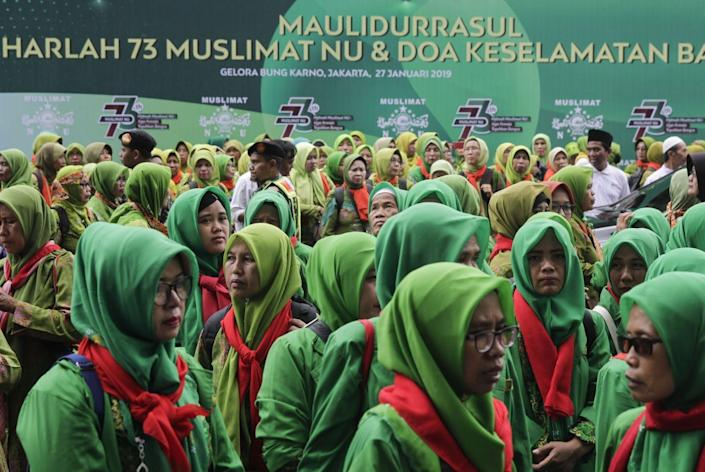 """<span class=""""caption"""">A gathering during the 73rd anniversary of the Nahdlatul Ulama (NU), in Jakarta, Indonesia in 2019.</span> <span class=""""attribution""""><a class=""""link rapid-noclick-resp"""" href=""""https://www.gettyimages.com/detail/news-photo/participants-are-seen-at-the-bung-karno-stadium-during-a-news-photo/1090184470?adppopup=true"""" rel=""""nofollow noopener"""" target=""""_blank"""" data-ylk=""""slk:Eko Siswono Toyudho/Anadolu Agency/Getty Images"""">Eko Siswono Toyudho/Anadolu Agency/Getty Images</a></span>"""