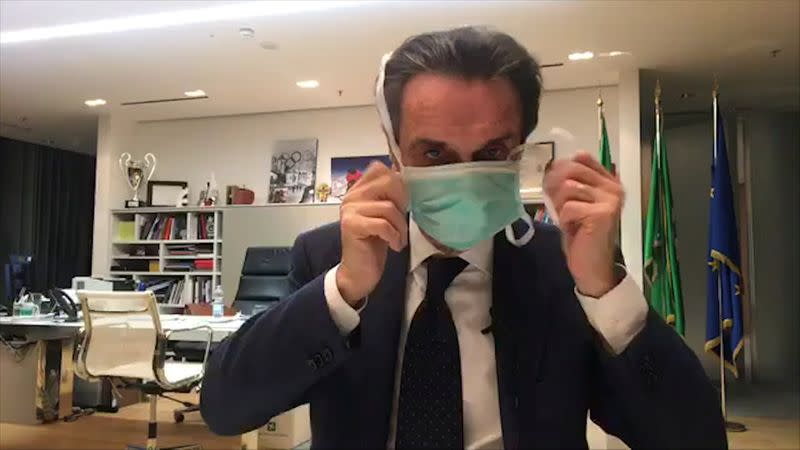 FILE PHOTO:  Head of Italy's Lombardy region in isolation after aide gets coronavirus