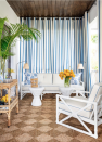 """<p>On the balcony off of her bedroom at the<a href=""""https://www.housebeautiful.com/design-inspiration/house-tours/g30731069/kips-bay-palm-beach-2020-design-tips/"""" rel=""""nofollow noopener"""" target=""""_blank"""" data-ylk=""""slk:Kips Bay Palm Beach show house,"""" class=""""link rapid-noclick-resp""""> Kips Bay Palm Beach show house,</a> Alessandra Branca gave one wall a fun stripe with a curtain from The Shade Store in a custom performance fabric—a weather-friendly alternative to traditional wallpaper. </p>"""