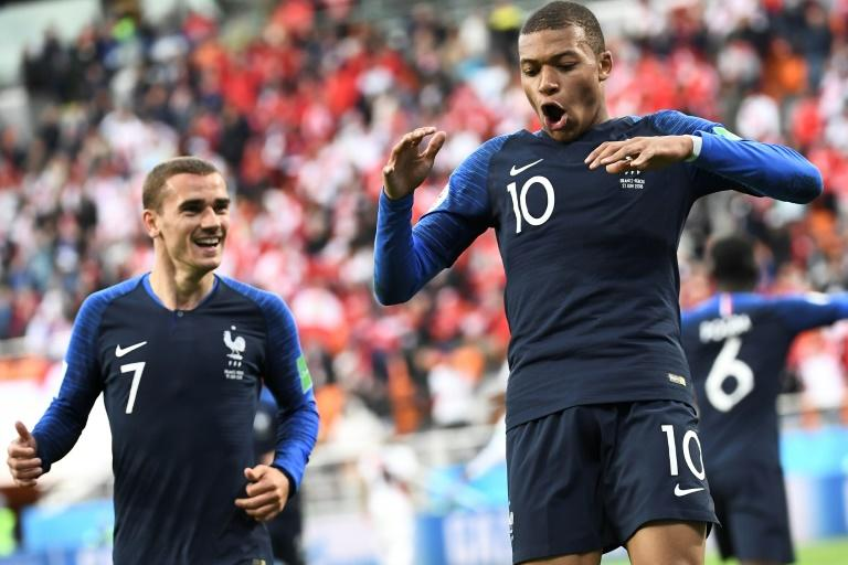 France's Kylian Mbappe (R) celebrates his goal against Peru at the World Cup