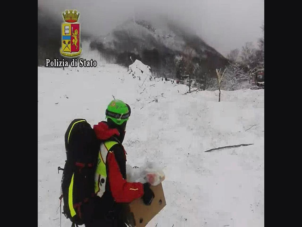 A rescuer carries food supplied by an Italian Police helicopter in front of the Hotel Rigopiano in Farindola, central Italy, hit by an avalanche, in this January 19, 2017 handout picture provided by Italian Police. Polizia di Stato/Handout via REUTERS   ATTENTION EDITORS - THIS IMAGE WAS PROVIDED BY A THIRD PARTY. EDITORIAL USE ONLY. NO RESALES. NO ARCHIVE.