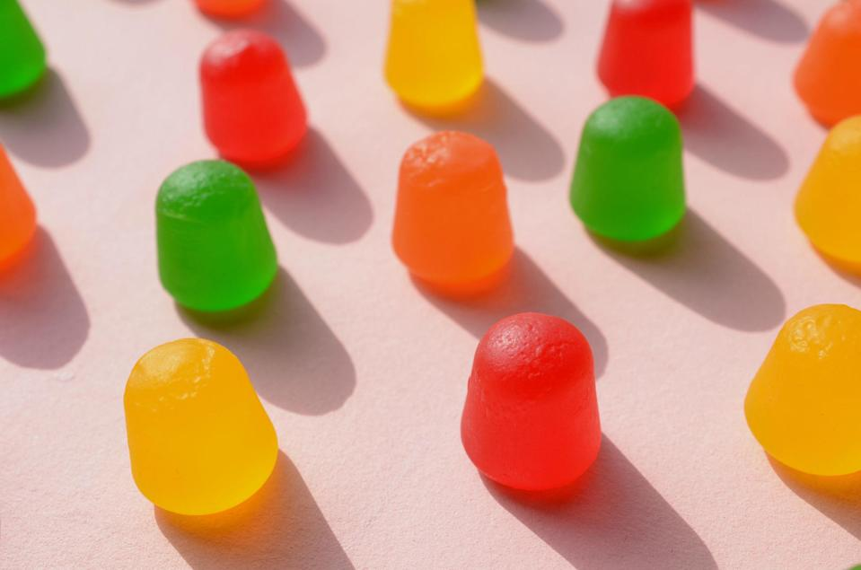 Colorful gumdrops arranged neatly on a solid background
