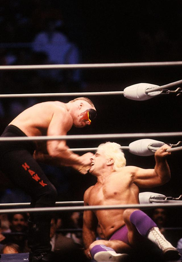 "<p>Road Warrior Hawk punches the ""Nature Boy"" Rick Flair in the corner during their Heavy Weight bout at the 1988 Bunkhouse Stampede on January 24, 1988 at the Nassau Coliseum in Uniondale, New York. (Photo by B Bennett/Getty Images) </p>"