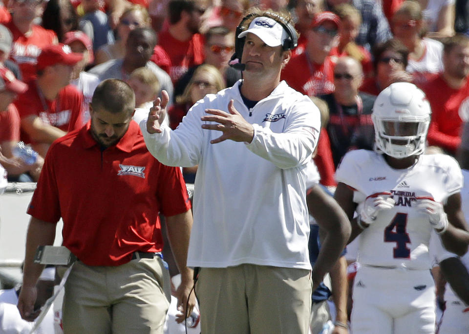 Florida Atlantic's Lane Kiffin gestures from the sidelines during an game against Wisconsin in 2017. (AP)