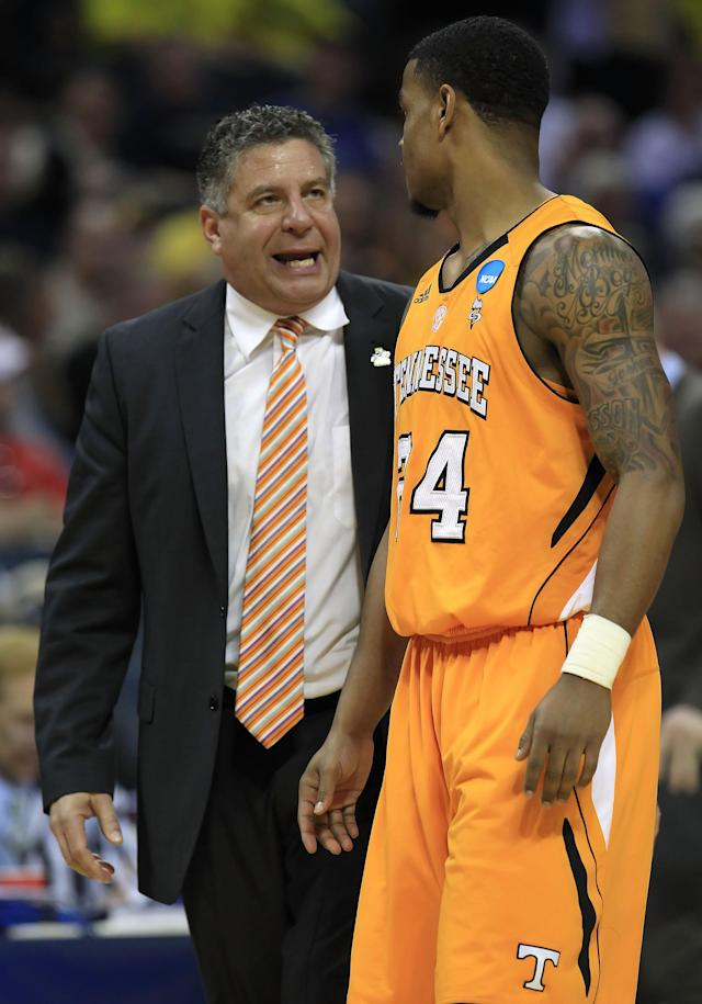CHARLOTTE, NC - MARCH 18: Head coach Bruce Pearl of the Tennessee Volunteers talks with Josh Bone #24 in the second half while taking on the Michigan Wolverines during the second round of the 2011 NCAA men's basketball tournament at Time Warner Cable Arena on March 18, 2011 in Charlotte, North Carolina. (Photo by Streeter Lecka/Getty Images)