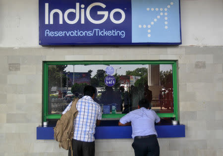 Passengers stand at the ticket counter of Indigo Airlines at the airport on the outskirts of Agartala