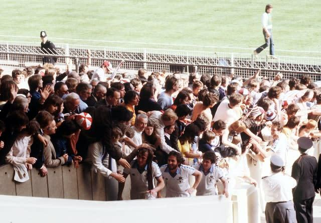 West Ham are congratulated by fans as they climb the steps to receive the FA Cup (PA)
