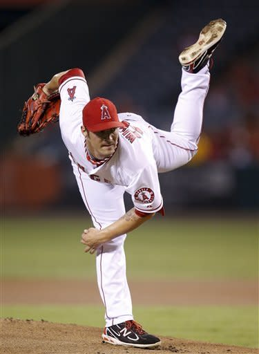 Los Angeles Angels starting pitcher C.J. Wilson follows through on a delivery to the Seattle Mariners during the first inning of a baseball game in Anaheim, Calif., Wednesday, Sept. 26, 2012. (AP Photo/Jae C. Hong)