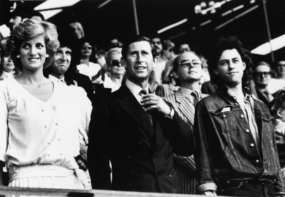 Princess Diana and Prince Charles stand with Bob Geldof in the Royal Box at Wembley Stadium today as they arrive for the start of the Live Aid Transatlantic Spectacular designed to raise millions of dollars for starving Africans, in London, on July 13, 1985.  Irish-born Geldof devised the concert that will be viewed in 160 countries through TV satellite link ups. REUTERS/Rob Taggart