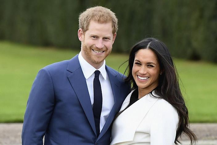 """<p>Harry, 33, and Meghan, smile at photographers following their engagement announcement at The Sunken Gardens in Kensington Palace. <a href=""""https://www.cosmopolitan.com/entertainment/celebs/a13939363/meghan-markle-prince-harry-engagement-interview-quotes/"""" rel=""""nofollow noopener"""" target=""""_blank"""" data-ylk=""""slk:In an interview conducted later that day"""" class=""""link rapid-noclick-resp"""">In an interview conducted later that day</a>, the couple revealed that Harry proposed over a roast chicken dinner at their cottage. Meghan's engagement ring was designed by Harry using a center stone from Botswana and two side stones from Princess Diana's personal collection.</p>"""