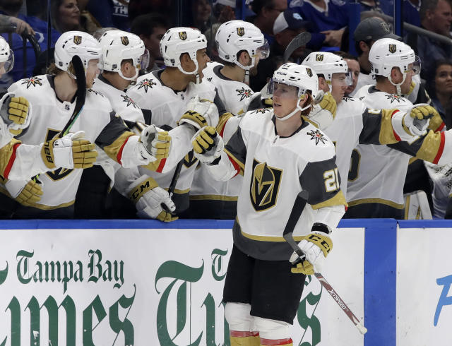 Vegas Golden Knights center Cody Eakin (21) celebrates with the bench after his goal against the Tampa Bay Lightning during the second period of an NHL hockey game Tuesday, Feb. 5, 2019, in Tampa, Fla. (AP Photo/Chris O'Meara)
