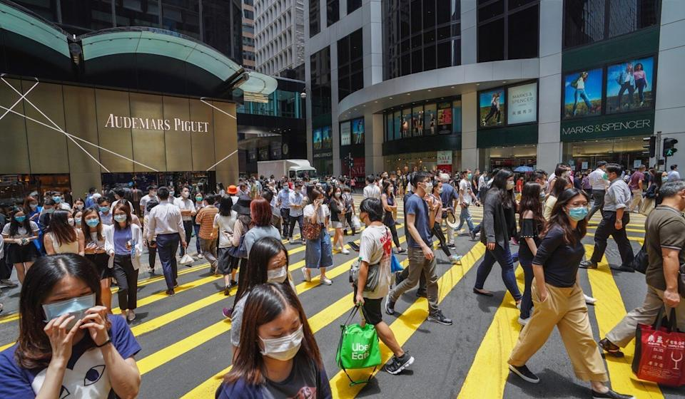 Office workers in the Hong Kong's financial district of Central. Photo: Winson Wong