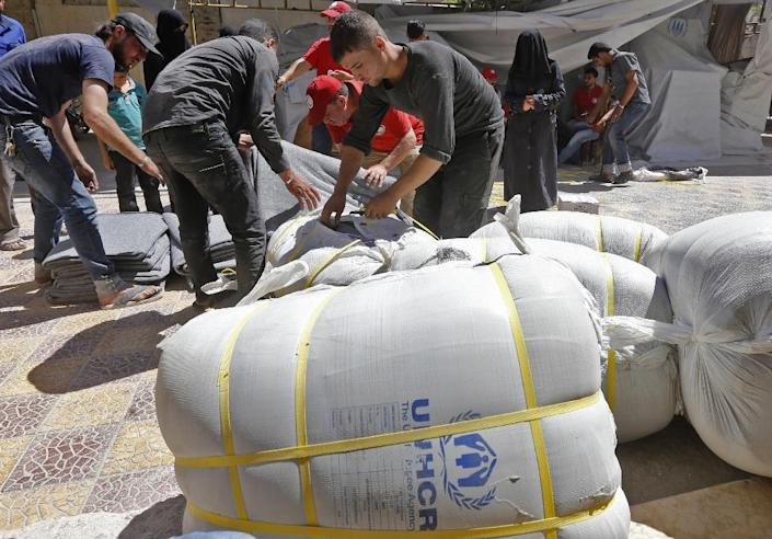 More than seven years into Syria's conflict, 13 million people across the country still need humanitarian aid, according to the United Nations (AFP Photo/LOUAI BESHARA)