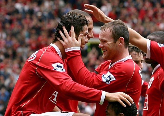 Cristiano Ronaldo (left) and Wayne Rooney (right) played together at Manchester United from 2004 to 2009 (Peter Byrne/PA).