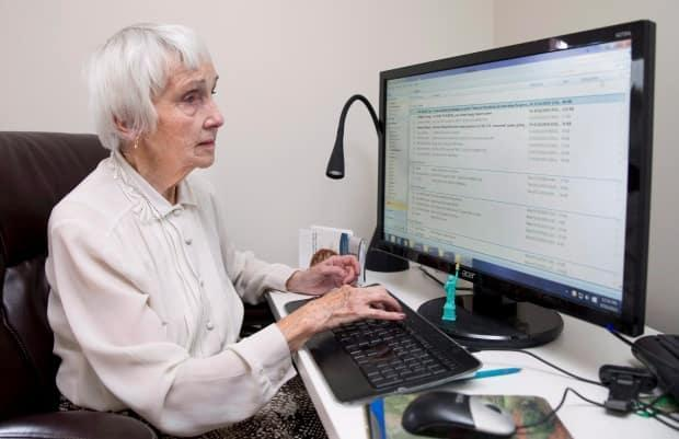 British expat and Second World War veteran Anne Puckridge works on her computer at her home in Calgary, Alta., on Friday, Sept. 16, 2016.