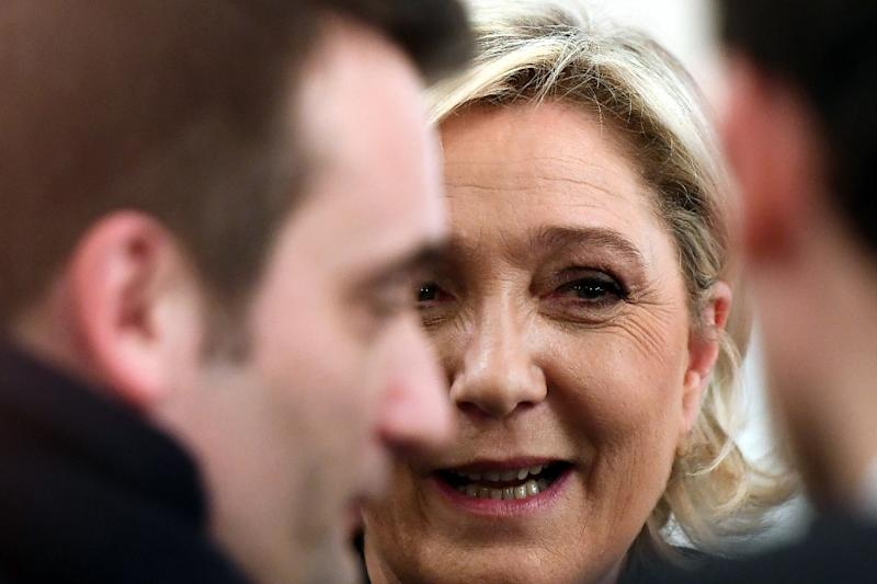 French far-right Front National (FN) party candidate for the presidential election Marine Le Pen speaks with FN vice-president Florian Philippot (L) after a press conference in Paris, on March 2, 2017 (AFP Photo/GABRIEL BOUYS)