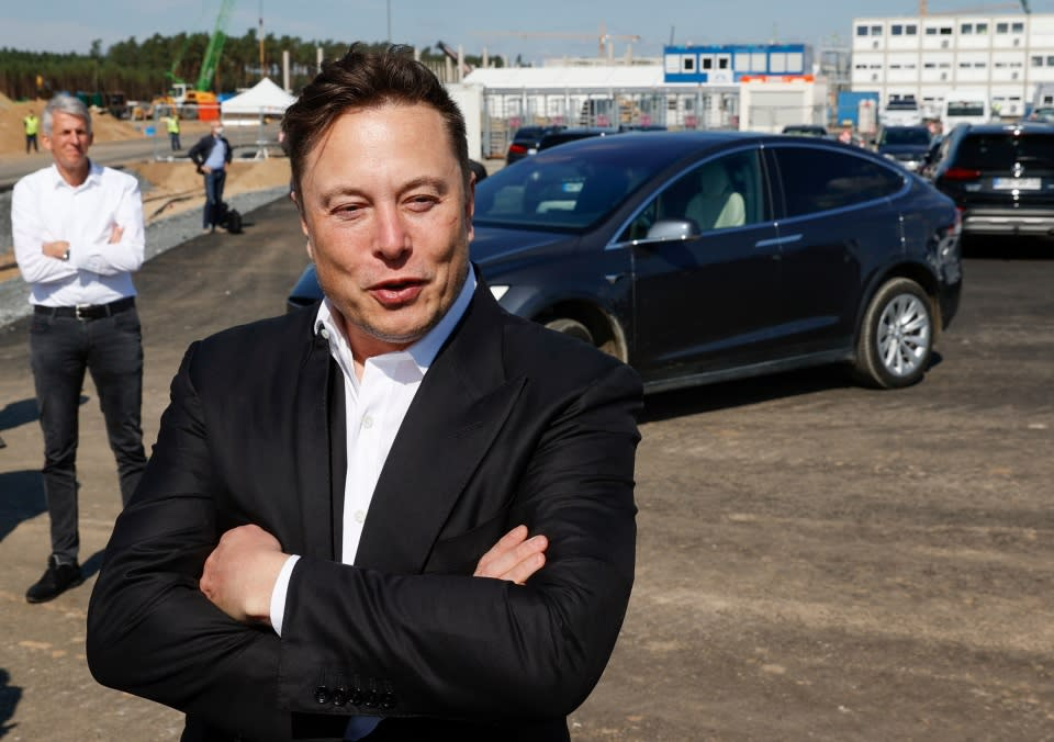 """Tesla CEO Elon Musk talks to media as he arrives to visit the construction site of the future US electric car giant Tesla, on September 03, 2020 in Gruenheide near Berlin. - Tesla builds a compound at the site in Gruenheide in Brandenburg for its first European """"Gigafactory"""" near Berlin. (Photo by Odd ANDERSEN / AFP) (Photo by ODD ANDERSEN/AFP via Getty Images)"""