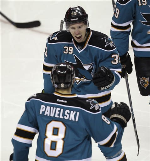 San Jose Sharks center Joe Pavelski (8) is congratulated by center Logan Couture (39) after scoring against the Detroit Red Wings in the first period of an NHL hockey game in San Jose, Calif., Saturday, March 17, 2012. (AP Photo/Paul Sakuma)