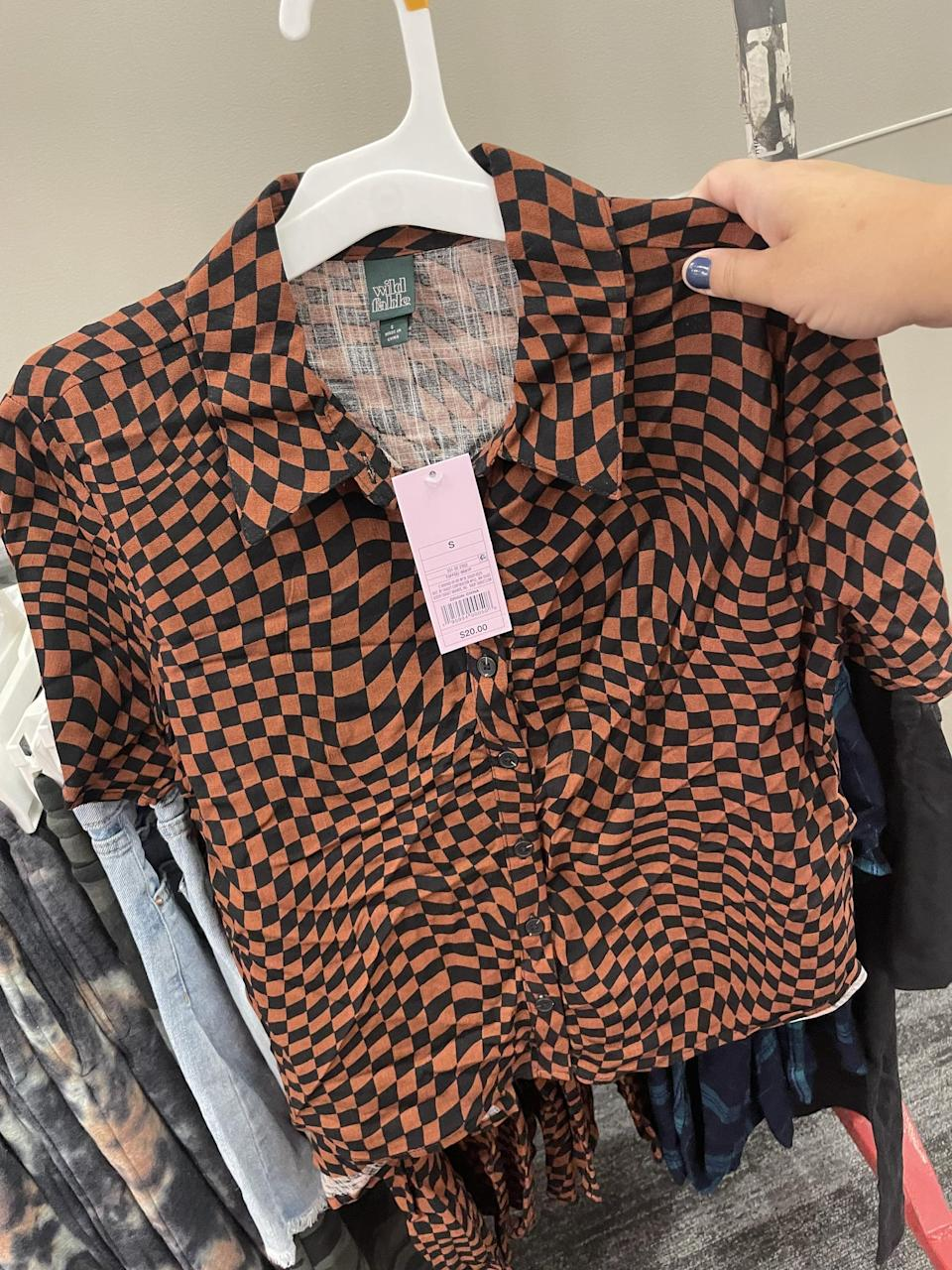 <p>I have been really into all the abstract checker print that's trending lately, and this <span>Wild Fable Short Sleeve Woven Button-Down Shirt</span> ($20) looks just like the designer options I've been eyeing. It will look great with black jeans and boots for fall.</p>