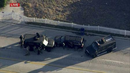 Police armored cars close in on a suspect vehicle following a shooting incident in San Bernardino, California in this still image taken from video December 2, 2015. REUTERS/NBCLA.com/Handout via Reuters