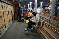 People wearing protective face masks prepare to ski at Ski Dubai during the reopening of malls, following the outbreak of the coronavirus disease (COVID-19), at Mall of the Emirates in Dubai